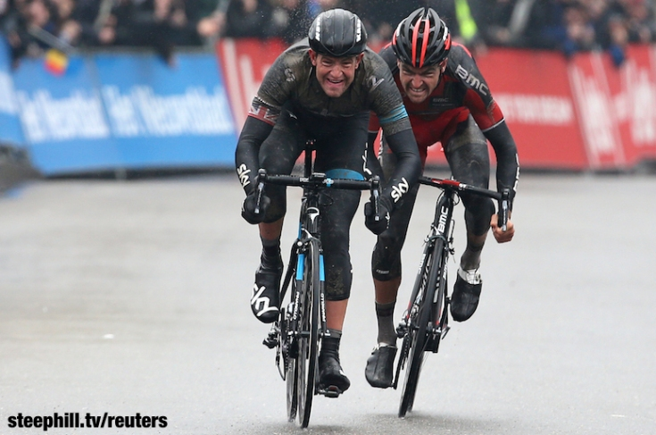 Sky team rider Stannard crosses the finish line to win the Omloop Het Nieuwsblad cycling race ahead of BMC Racing team rider Van Avermaet in Ghent